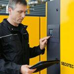 Technician performing air compressor preventive maintenance