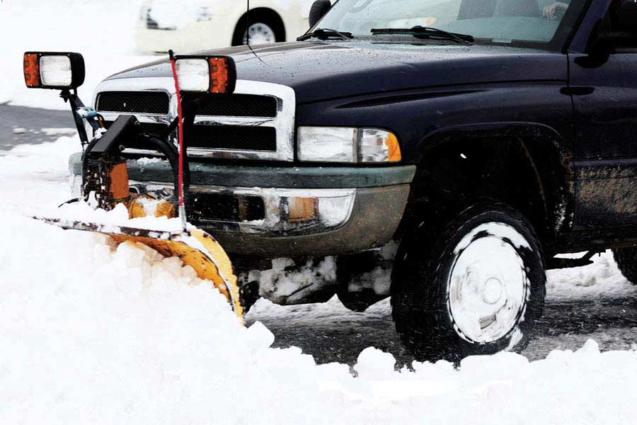 snow plow truck clearing snow